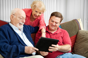 Adult Son Assisting Elderly Parents