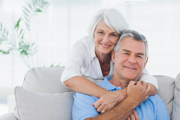 Mature Woman Embracing Husband