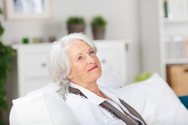 daydreaming-smiling-elderly-woman